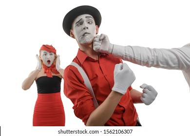 Men fighting over a woman. Funny grimace with crossed eyes after a punch in the jaw. Defend or protect a girl concept.