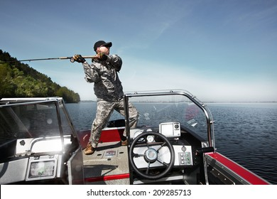 Men is fishing at the boat