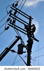 Men fixing electrical line