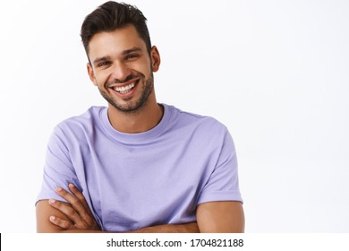 Men, generations and wellbeing concept. Good-looking charming boyfriend in purple t-shirt, with beard smiling enthusiastic, look kind and pleasant expression, cross arms over chest stand casual pose