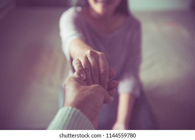 Men giving hand to depressed woman,Huasband support and encourage wife,Psychiatrist holding hands patient,Mental health care concept