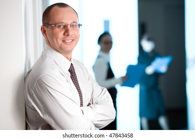 Men in glasses with tie and with smile