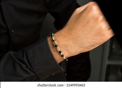 Men gold bracelet on hand