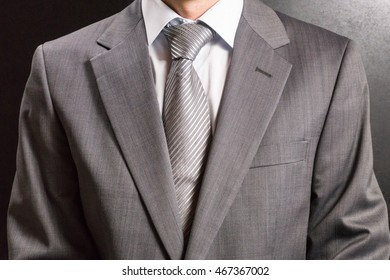 Men in grey suit