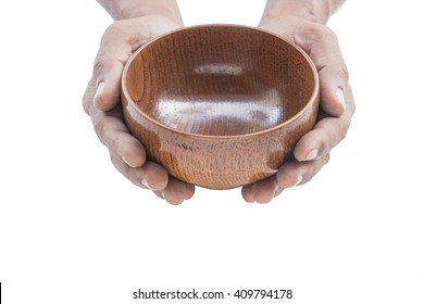 Men hand holding empty wooden bowl  on white background, generous concept.