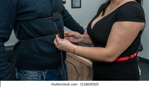 a men hand on which a polygraph sensor is put on