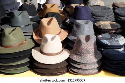 Men hats of different shapes and style display in a clothing store market.
