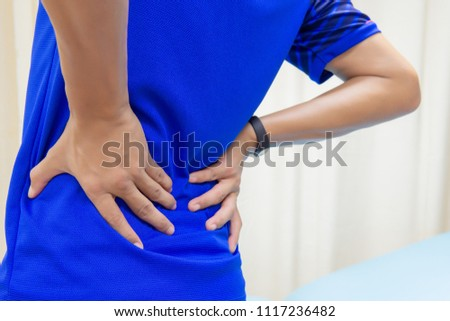 men have back pain caused by stock photo edit now 1117236482