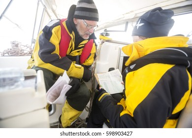 Men Having Discussion On Yacht