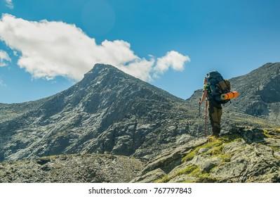 Men hiking in mountains. Siberia.