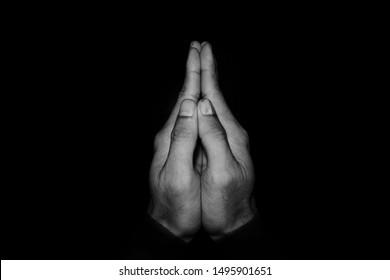 Men hold hands in prayer and prayer posture