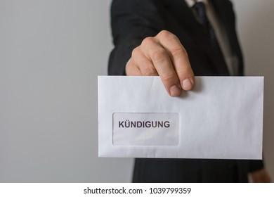 "men holding letter with german word ""Kündigung"" (Job termination)"