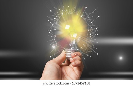 Men holding light bulbs, of new ideas with innovative technology and creativity.