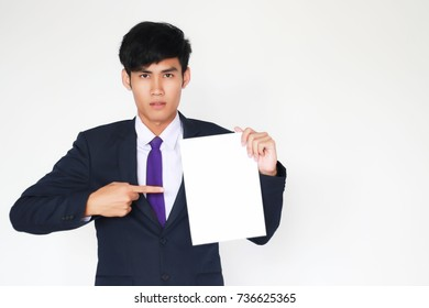 Men holding a white paper, about business. (selective focus,out of focus)