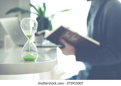 Men and hourglass,relax in the room