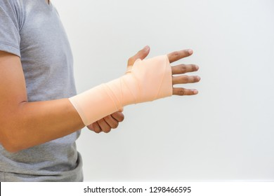 Men injured by tendon inflammation by using Elastic Bandage. To help reduce injuries and reduce swelling. Medical and healthcare concept