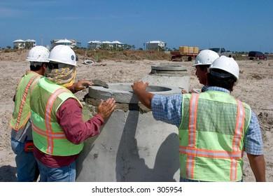 Men Installing a Manhole