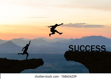 Men jump over silhouette failure commitment to success