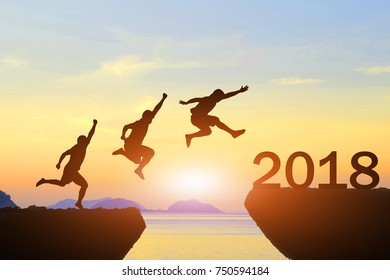 Men jump over silhouette Happy New Year 2018