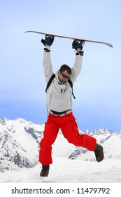 Men jumps with snowboard in two hands