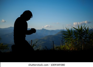 Men kneeling, mountain bases, praying to God