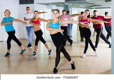 men and ladies dancing aerobics at lesson in the dance class