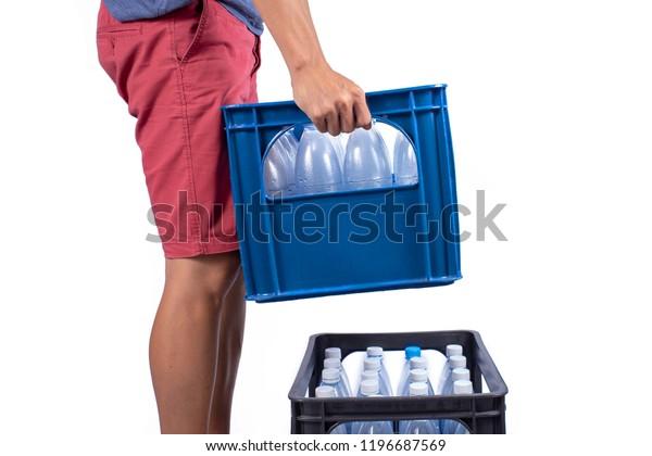 Men Lifting Plastic Crates Water Bottles Stock Photo (Edit Now) 1196687569