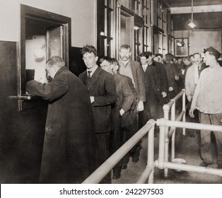 Men in line to register at the six-story New York City Municipal Lodging House at 25th Street between First Avenue and the East River. 1914.
