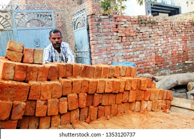 Men loading bricks in the horse cart.