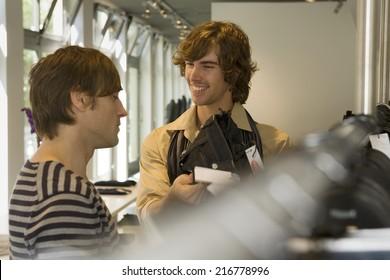 Men looking at clothes at a boutique.