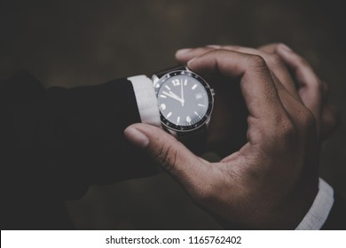 men looking at luxury watch on hand check the time.concept for managing time.