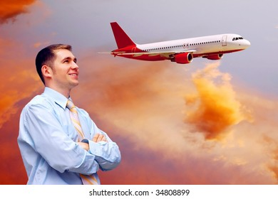 men looks at airplane in air with sunrise sky