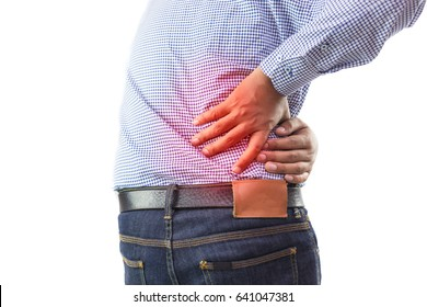 Men with low back pain on a gray background / medical and health concepts.