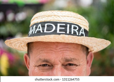 a men with a Madeira Hut at the Festa da Flor or Spring Flower Festival in the city of Funchal on the Island of Madeira in the Atlantic Ocean of Portugal.  Madeira, Funchal, April, 2018