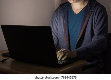 Men or Male Working or Playing Laptop Notebook Computer at Dark Night as Late Working Concept.