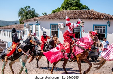 "Men masked on horseback, who are part of the ""cavalhada"", Brazilian Christian festival in the city of Pirenópolis, State of Goiás, Brazil. May 2015."