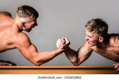 Men measuring forces, arms. Hand wrestling, compete. Hands or arms of man. Muscular hand. Arm wrestling. Two men arm wrestling. Rivalry, closeup of male arm wrestling. Two hands.