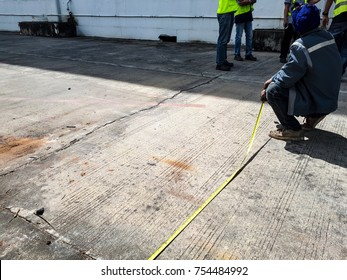 Men are measuring the ground.