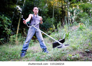 Men mow the weeds