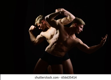 men with muscular torso and strong male abs, fitness model in gym, twins