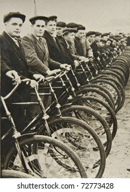 Men on bicycles, the beginning of the competition. Old photographs.