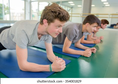 men on the mat