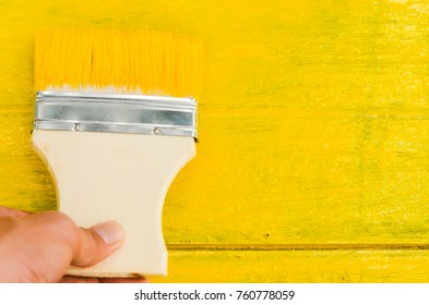 Men are painted yellow background for equipment stock photography.