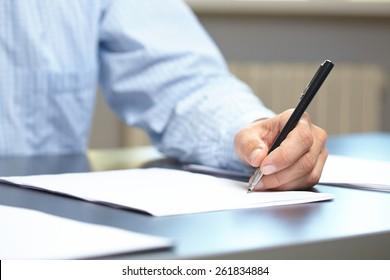 men with pen