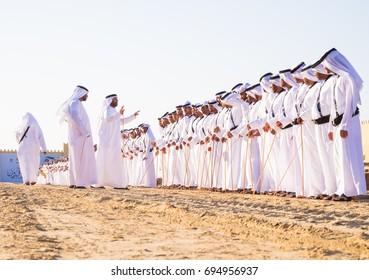 Men perform Yawalah traditional dance  in SHEIKH ZAYED HERITAGE FESTIVAL September 22, 2014 in Abu Dhabi, united arab emirates