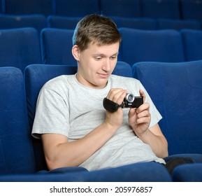 Men pirating. Young men pirating at the cinema
