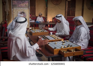 Men play a popular game to celebrate National Day, Doha Qatar, December 2014