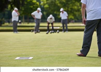 Men playing lawn bowls. Narrow depth of field.