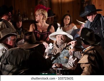 Men point guns at elderly gambler set up by woman