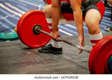 men powerlifter start attempt deadlift competition in powerlifting